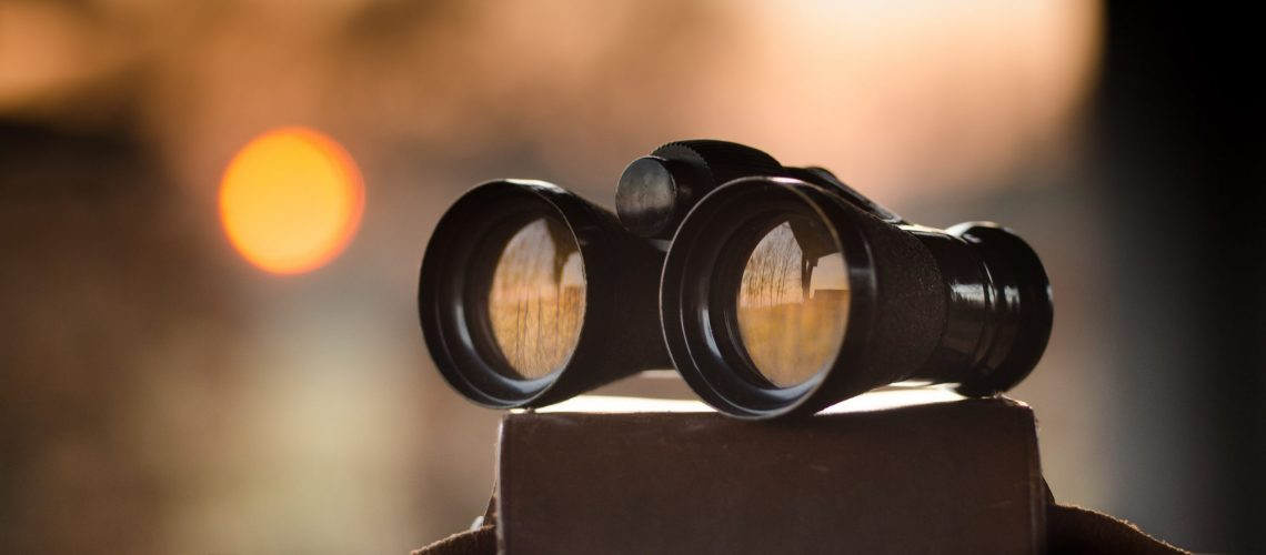 black-binocular-on-round-device-63901