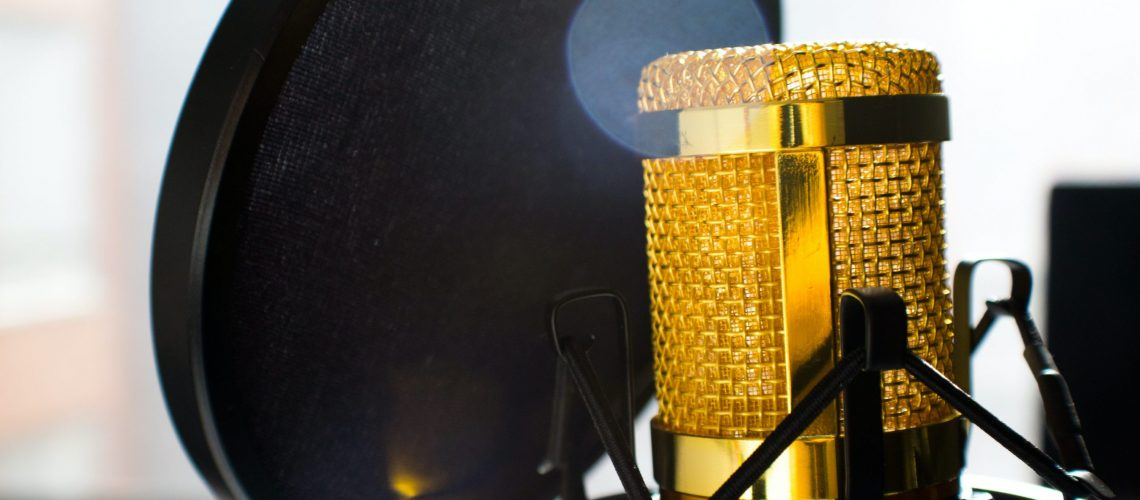 close-up-photo-of-gold-colored-and-black-condenser-682082