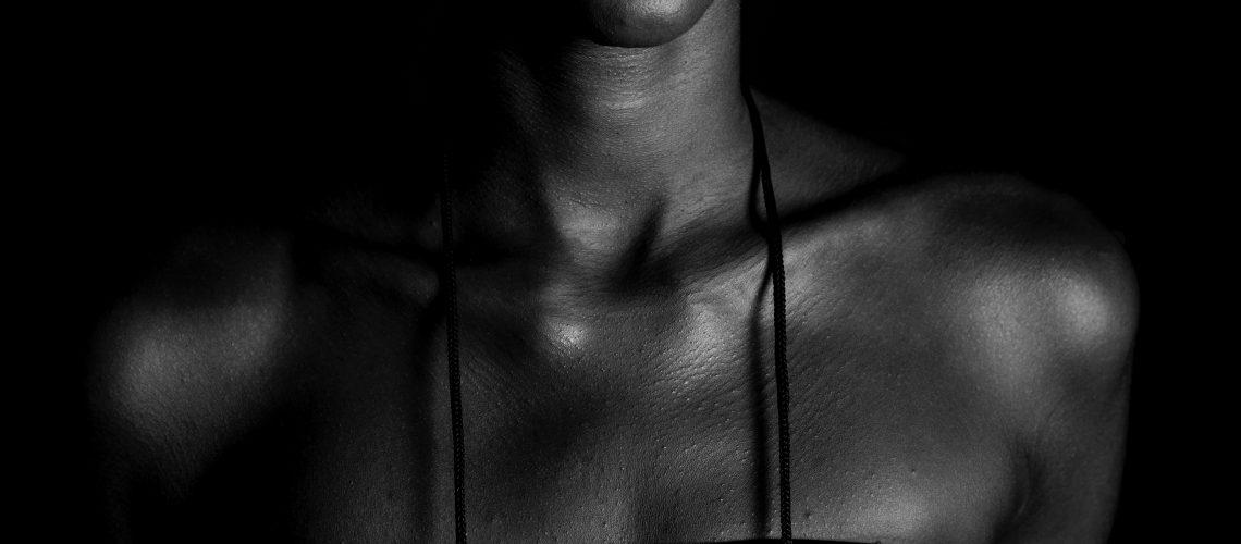 grayscale-photo-of-woman-wearing-strapless-dress-1460998