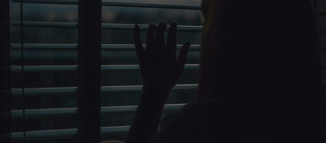 silhouette-of-woman-looking-out-window-1995550