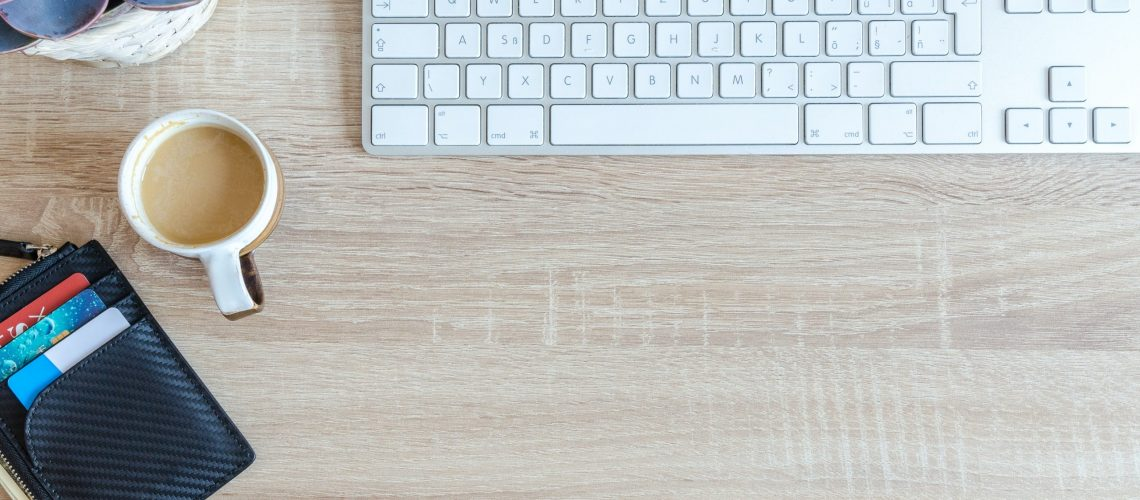 white-apple-keyboard-near-white-cup-917463